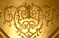 the gold-embossed ceiling