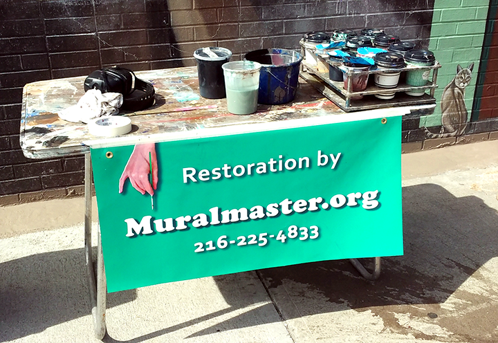 my painting setup with the restoration sign