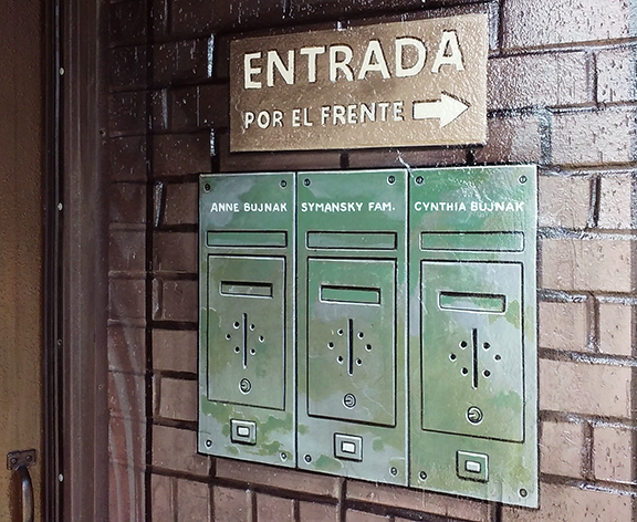 sign and mailboxes