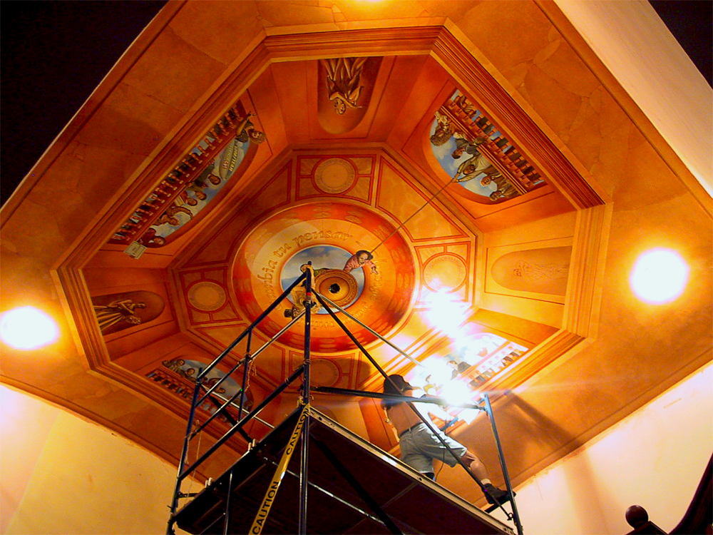 john rivera-resto painting the gordon square theater ceiling mural