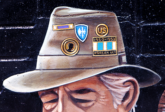 close up detail of the veteran's hat