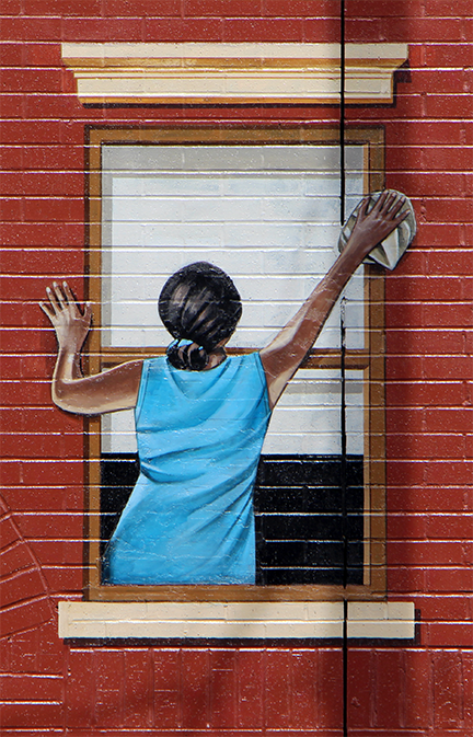 lady cleaning window