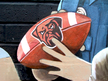 detail of cleveland browns football with dog emblem