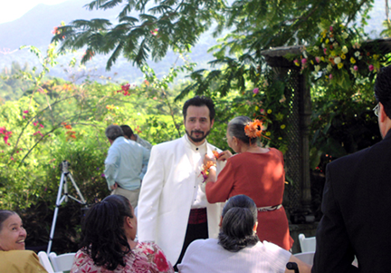 john-rivera-resto-and-nancy-lewis-wedding,-John's-mom-placing-the-boutonniere
